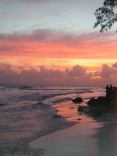 A romantic walk along a Barbados beach at sunset. Barbados, one of