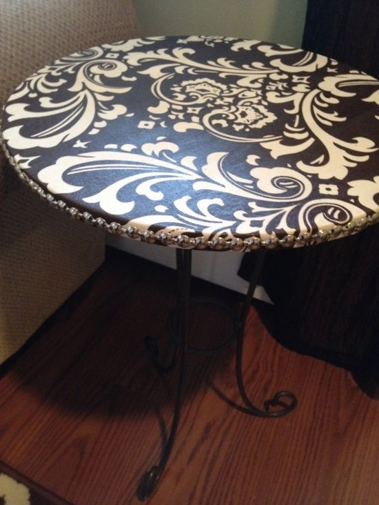 cover old tables with fabric and use mod podge to seal. I have a table now that I could use this idea. Thanks!