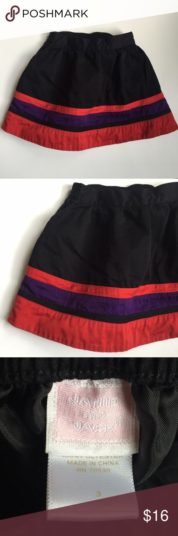 Janie & Jack black ponte skirt sz 3. Stripes! Janie & Jack black ponte skirt. Size: 3. Red and purple stripes at hem. Elastic at back of waist band. Fully lined. Beautiful skirt. Great preowned condition. Janie and Jack Bottoms Skirts
