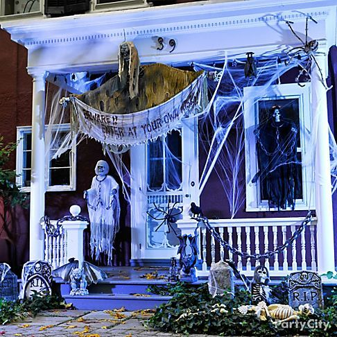 Create your spooky front door scene with Halloween decorating ideas like cobwebs, scary signs, terrifying tombstones and grim reapers!