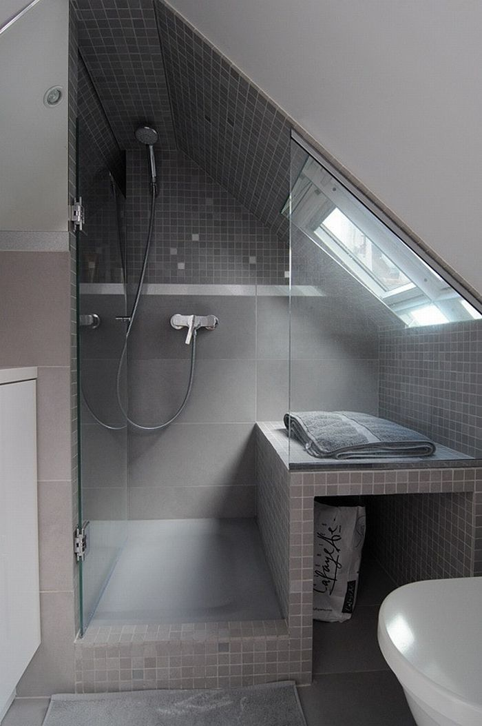 16m2 bathroom with grey tiles, mozaic and tilted wall. just the inspiration we need for our bathroom!