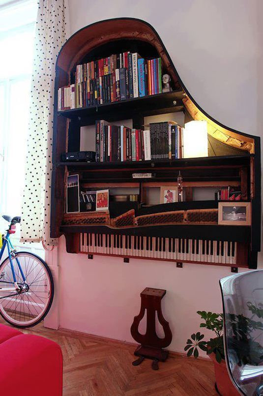 Old grand piano turned into a beautiful book shelf. Love this for the music teachers office :-)