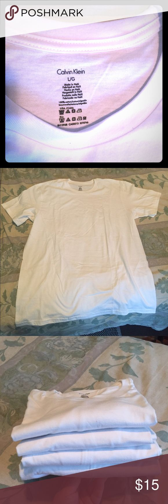 Four NWOT Calvin Klein Men's Shirts These shirts are a men's size large. They were purchased for my boyfriend who has no need for them! I am willing to see these individually if you are not looking for four new shirts! Please feel free to message me or make an offer! Calvin Klein Shirts Tees - Short Sleeve