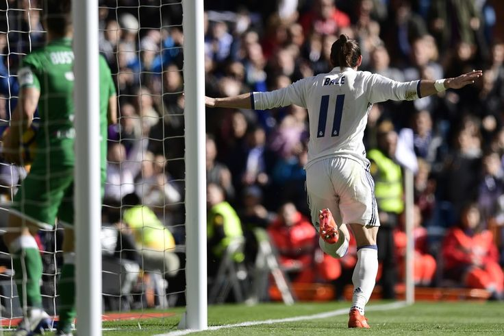 Real Madrid's Welsh forward Gareth Bale celebrates after scoring a goal during the Spanish league football match Real Madrid CF vs Club Deportivo Leganes SAD at the Santiago Bernabeu stadium in Madrid on November 6, 2016.