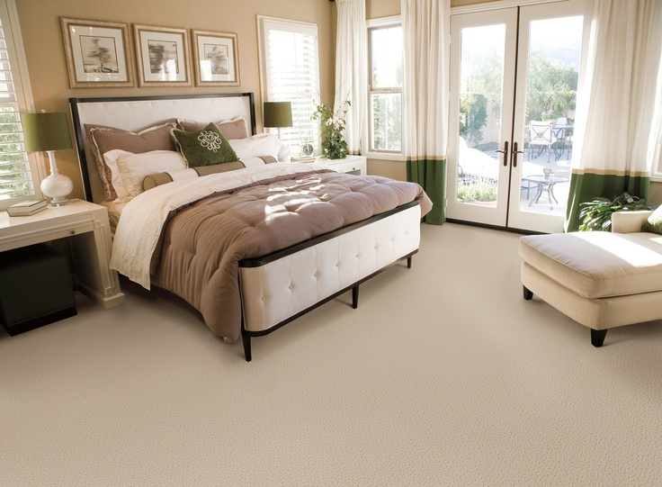 A neutral palette with green accents make this bedroom feel light and fresh - just like spring.