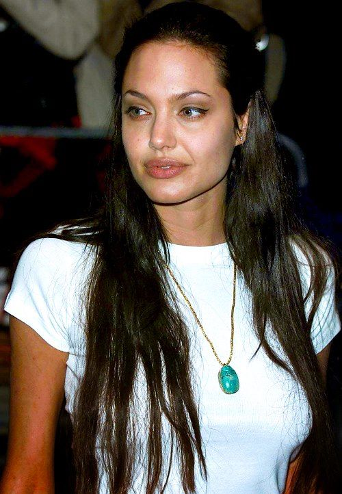 Angelina jolie native looking with her long hair and turquoise necklace