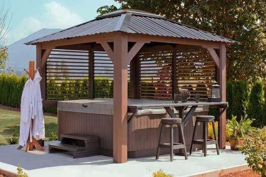I would love to add a hot tub like this in my yard. It has a bar to put things. Also, it has the gazebo and that would be nice to keep rain or snow off of the hot tub.