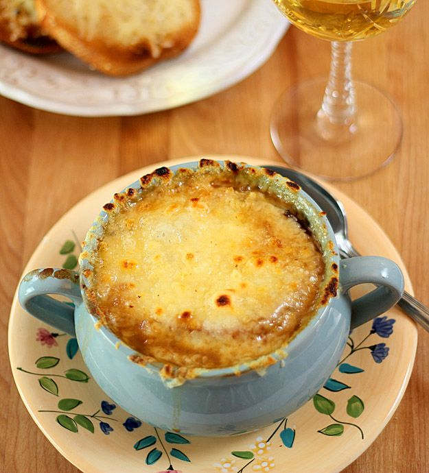 During it's heyday, Famous-Barr Department Store in St. Louis had a wonderful version of French Onion Soup. It was thick and rich, and came from the kitchen in a brown pottery soup bowl bubbling with melted Gruyere cheese atop two slices of French baguette. It was heaven in a bowl! The store used to sell the soup frozen, along with packages of grated Gruyere cheese.