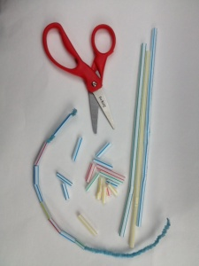 An Occupational Therapist tells us how cutting straws can work on visual spatial skills, hand strength, bilateral control, and more.  And then you can use the pieces for a beading activity!  Visit pinterest.com/arktherapeutic for more #finemotor therapy ideas