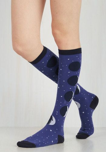 These celestial knee-highs aren't just a phase - they're a pair you'll love to the moon and back now and forever! Detailed with each intriguing stage of earth's favorite satellite, these socks will collect compliments for light years to come.
