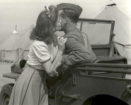 Girl kissing soldier. World War 2