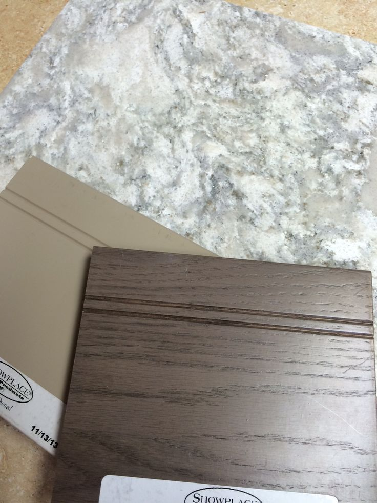 Cambria quartz Berwyn with Showplace wood samples in dark stain and painted.