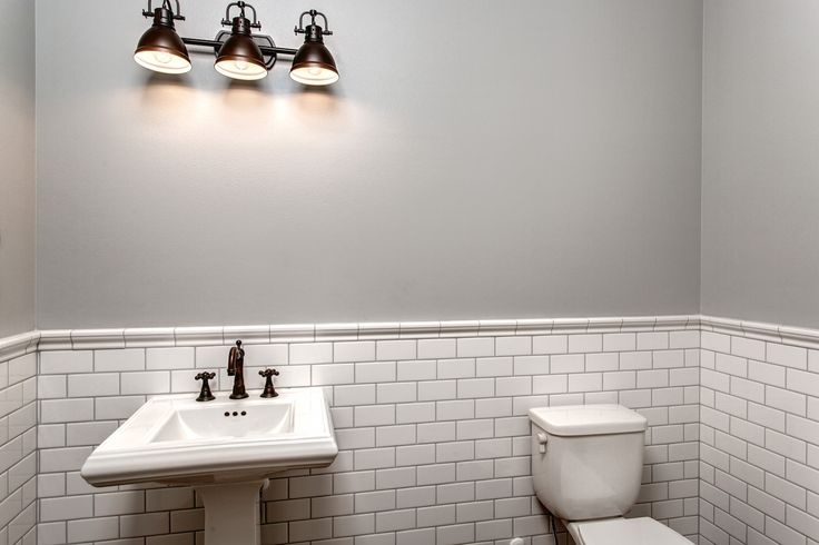 Turn your bathroom into a sacred place, by adding white back splash and drop in sinks. Put your shower in its own room to make your shower time 'me time'. By American Classic Homes.