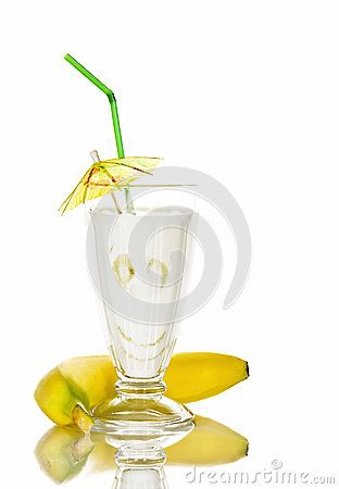 Banana cocktail   in a glass with a straw in a still life.isolated background.
