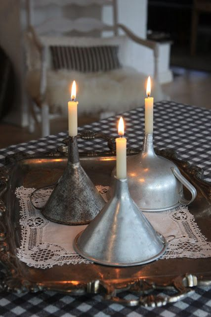 Use antique funnels to hold candles.....although you need the amazing doily under it too
