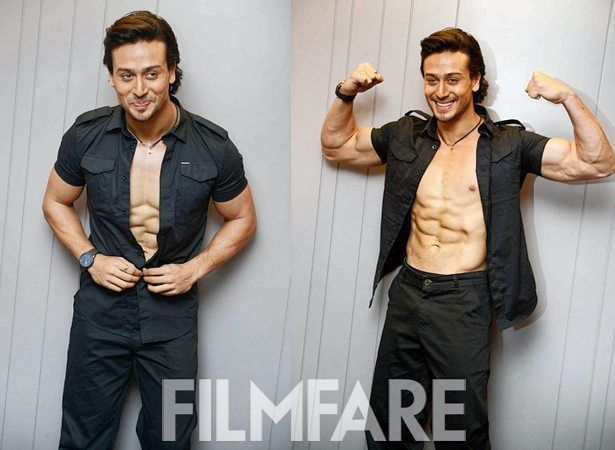 Tiger Shroff definitely follows the 'If you got it flaunt it' mantra! Spotted at a promotional event for his upcoming movie Baaghi in Delhi the young actor wooed all his fans by taking his shirt off and had everyone drooling over his chiseled abs and well-crafted body. by #Filmfare. Shared by #BollywoodScope
