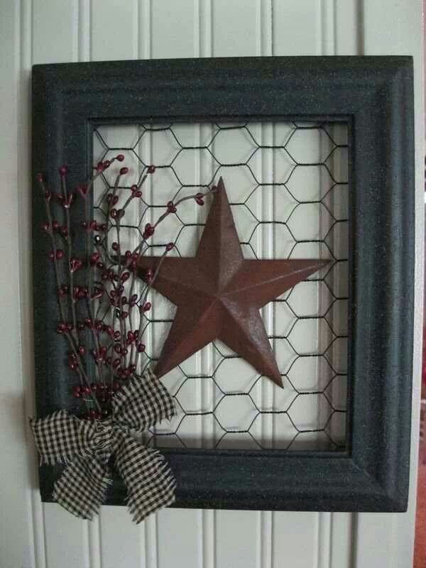 chicken wire in a picture frame, star, branch of berries and a bow