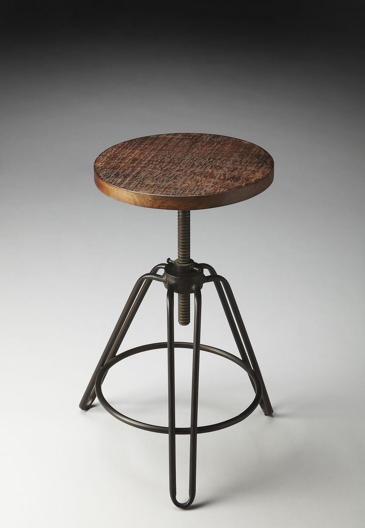 This charming industrial-look barstool revolves and adjusts to the desired height, making it an ideal seat for all sizes and tables. With a distressed recycled wood seat, its three-legged design ensur