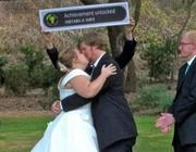 "As this groom kissed his new bride, an officiator held up this ""achievement unlocked"" sign, which is a feature on Xbox Live that doubles as a meme. According to attendees, both are avid gamers, and the bride actually made the sign as a surprise for him. 
