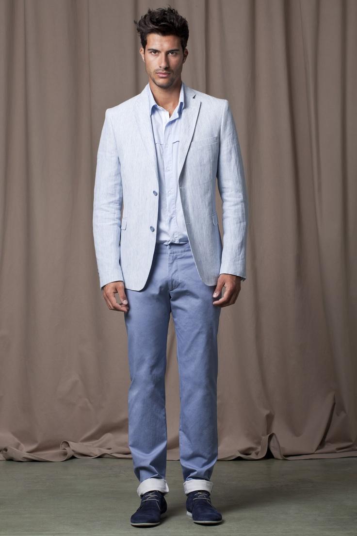 Powder blue blazer and shirt, light blue chinos and navy blue chukka boots