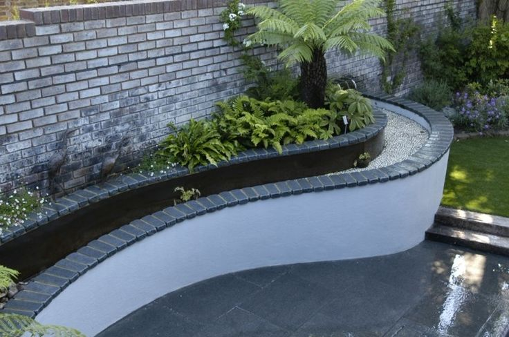 diseño fuente agua borde jardin