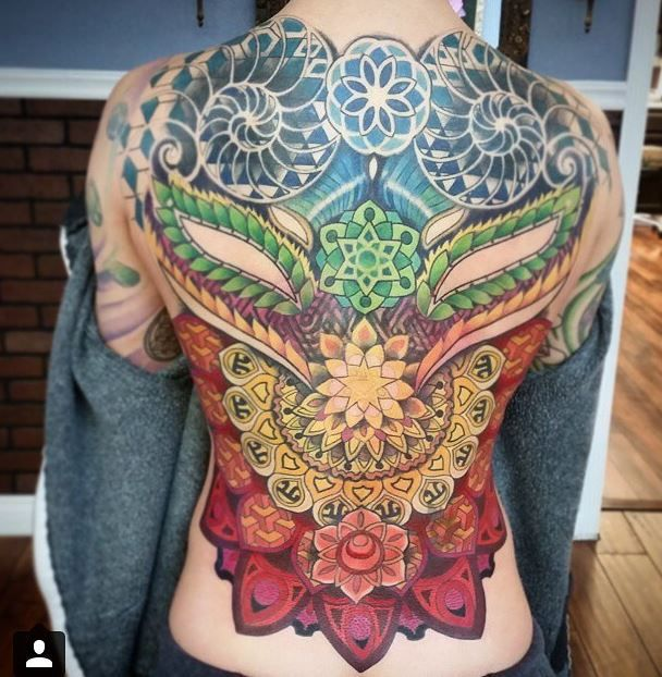 Full back piece by Anthony Ortega Beautiful work. Geometric shapes perfectly integrated with elements from nature.  Creative and captivating.