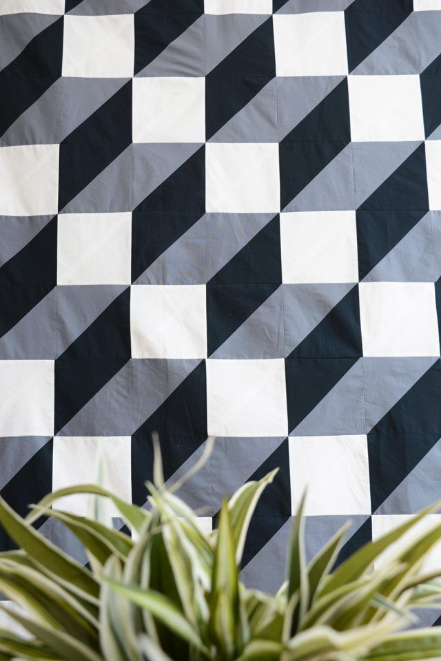 Elongated tumbling blocks quilt made with HSTs.  Tutorial by Jeran McConnel at EHow.