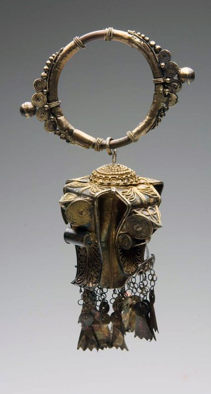 Indonesia - Sumatra | One of a pair of earrings, worn by Karo women ~ 'Karabu kudung-kudung ' | ca. 1998 or earlier || These are either worn through the earlobe or attached to their headscarf