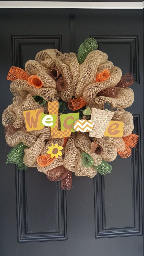 This beautiful fall deco mesh wreath is made on a 16 inch wire wreath frame. Wonderful colors for the changing of the season! Help welcome your guests