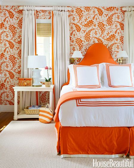 Spicy orange energizes the master bedroom. China Seas' Lysette linen covers the walls, and the headboard is upholstered in a Norbar canvas. Meridian bed linens, Matouk. Hamilton table, Bunny Williams