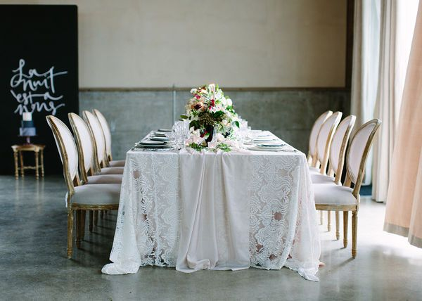 Lace linens and beautiful floral arrangements for romantic wedding inspiration.