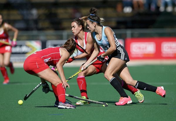 Eugenia Trinchinetti of Argentina and Josefa Villalabeitia of Chile battle for possession during day 2 of the FIH Hockey World League Semi Finals Pool B match between Argentina and Chile at Wits University on July 10, 2017 in Johannesburg, South Africa.