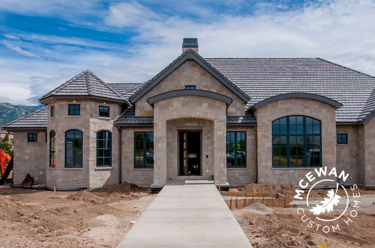 Unique design creates this whimsical exterior l McEwan Custom Homes #mcewancustomhomes #smalldetailsbigdifference #exterior #home #homebuilder #homebuilding #homedesign #design #newhome #newconstruction #custom #custombuilder #customhomes #customdesign  #utahhomes #utahvalley