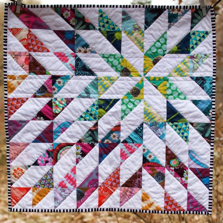 It is a terrible weather day to take a quilt pic -- but my Pretty Potent Petal miniquilt is on its way to my swap partner!   I hope...