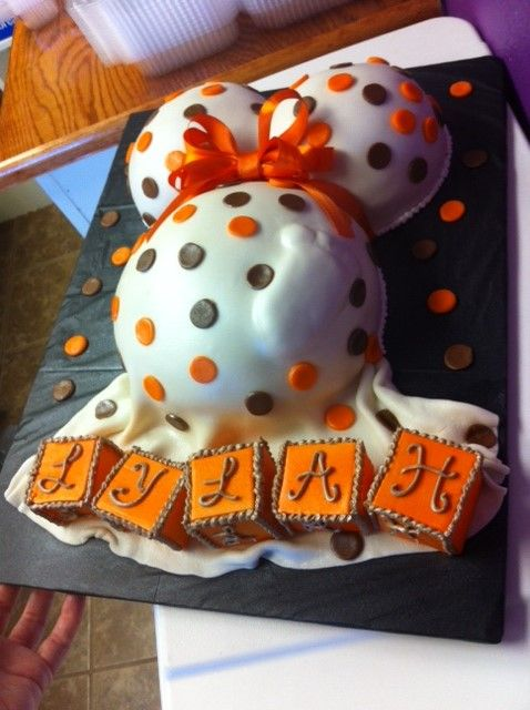 beautiful fall themed baby shower cake with edible blocks and a baby