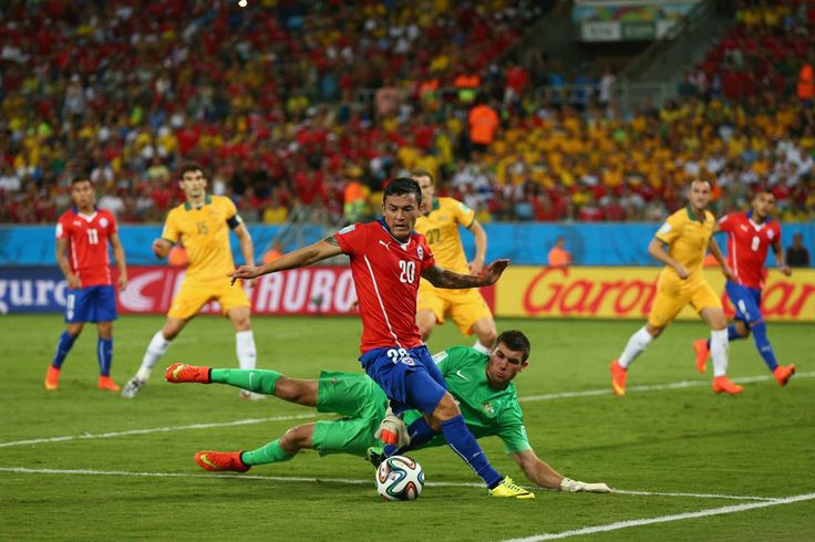 Charles Aranguiz of Chile controls the ball in front of goalkeeper Mathew Ryan of Australia during the 2014 FIFA World Cup Brazil Group B ma...