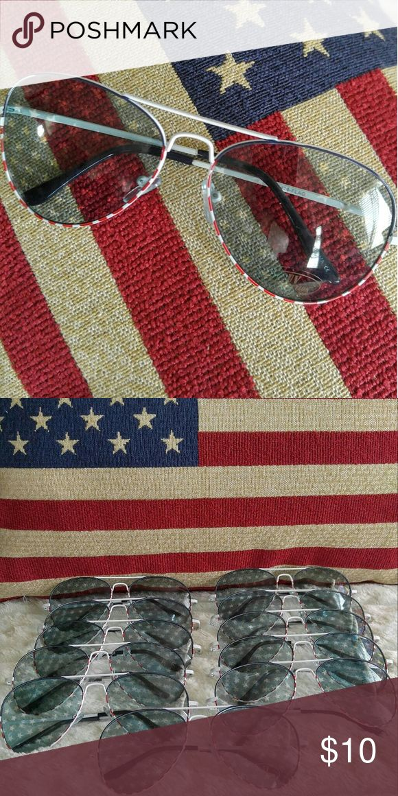 American Flag Star Printed Sunglasses American Flag Star Printed Sunglasses with red stripes along the bottom of the frames. New without tags. Accessories Sunglasses