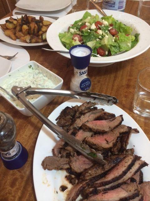 Oregano marinated greek organic lamb leg with salad and oregano and lemon potatoes
