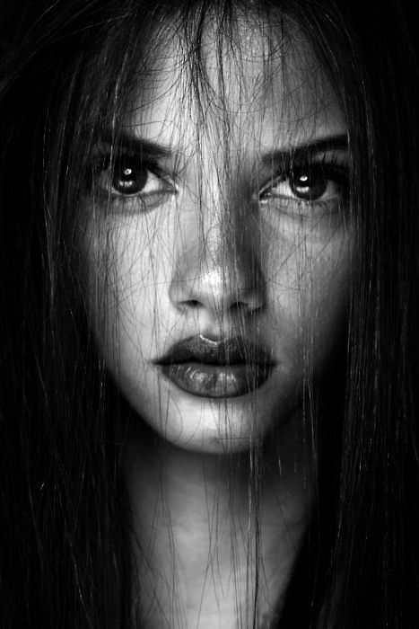 This photo punches me in the face. Love it. Can't tell if there was some feature exaggeration in Photoshop or not... Marina Nery.