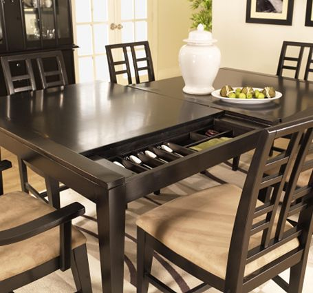 Smart. Fashion meets function with this adaptable Perspectives storage table. Great as a dining room table or office desk, this versatile, modern piece allows you to store flatware, laptops and office supplies with ease. Simply slide either side of the tabletop up to reveal felt-lined storage compartments that are totally customizable thanks to removable partitions.