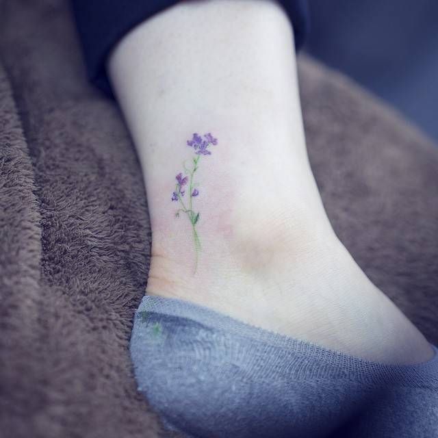 Watercolor style sweet pea flower tattoo on the ankle. Tattoo artist: Sol Tattoo