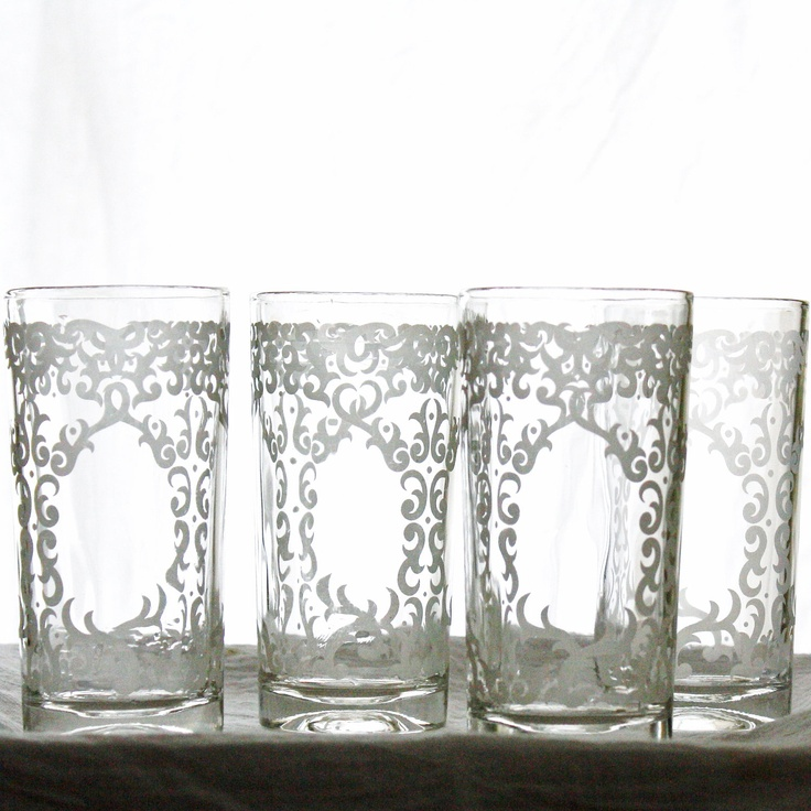 Etched Glass vintage set of 4 drinking glasses. Intricate Boho scrolling details all the way around each glass.. $50.00, via Etsy.