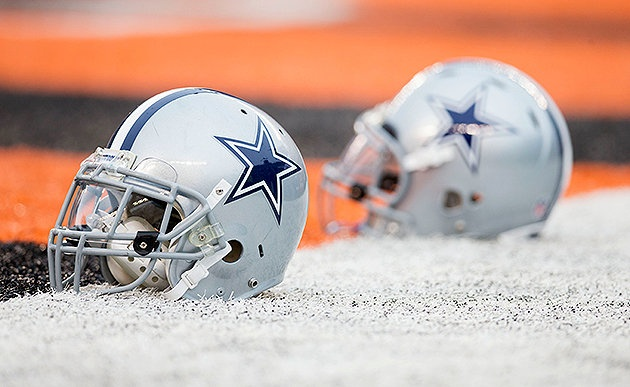 Two Dallas Cowboys helmets sit in the end zone before the game