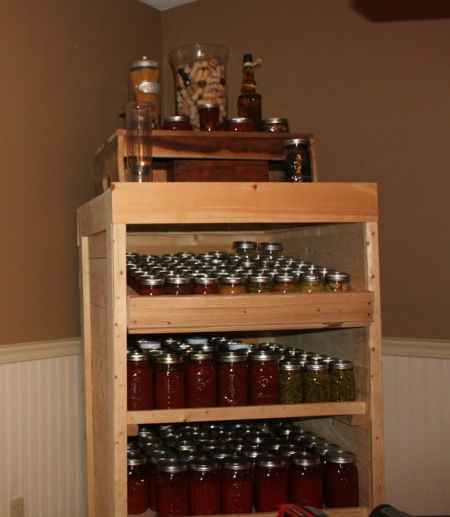 DIY Wood Pallet Canning Pantry - stores up to 200 canning jars... #woodpallets #canning #storage