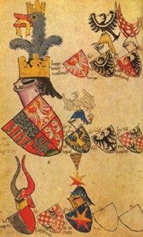Nagy Lajos címere - sisak lovas forma, nyakra nyúló rész valamint a szűk látótér - a korban igen fejlett, ritkább átmeneti tornasisak. Arany korona - királyi vérvonal, regnálás (Nagy Lajos heraldikai betoldása - bár ennek az időben később íródott Thuróczy krónika ellent mond). Strucc középkorban: 1. Mindent felfal (mindent legyőz) 2. Legyőzi a lovat mint természetes ellenfelet. Patkó - a kívánt szerencse, strucc megeszi a lovat. Ezt a jelet viselőt minden lovag ellen győzelemre segíti.