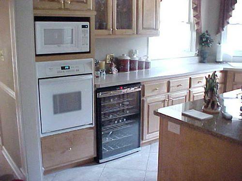 Kitchen: wall oven, microwave, wine fridge.
