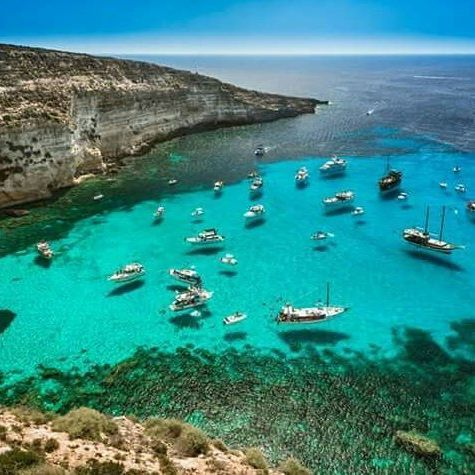 """Once upon a time this charming and large stretch of coast, that #Lampedusa islanders like to call """" the Pool """" , was the ideal destination for sailing ships seeking shelter from bad weather; here the sailors waited for a dead calm sea smoking dozens of cigars, so that's why the bay is, perhaps, called the """"Tabaccara"""". Photo by @ Massimo Calcagno #springinsicily #yummysicily"""