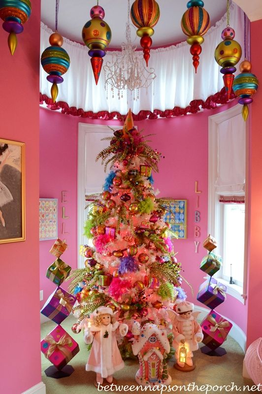 Pink girl's bedroom decorated with a whimsical Christmas tree tucked into the turret in the Victorian home belonging to Governor Roy and Marie Barnes.