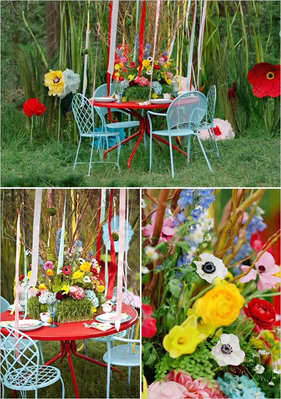 Super Cute Garden Party... table streamers and over scale paper flowers vibrantly colorful and fun!