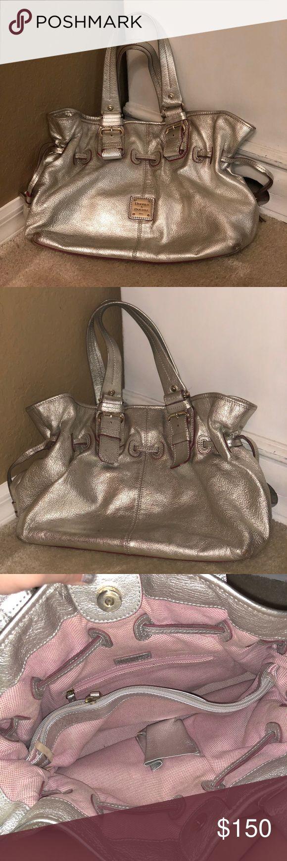 Dooney & Bourke, large silver shoulder bag Large dooney & bourke silver handbag with a large center divider pocket. In great condition, lightly worn. Authentic. Soft leather. Make an offer!!! Dooney & Bourke Bags Shoulder Bags